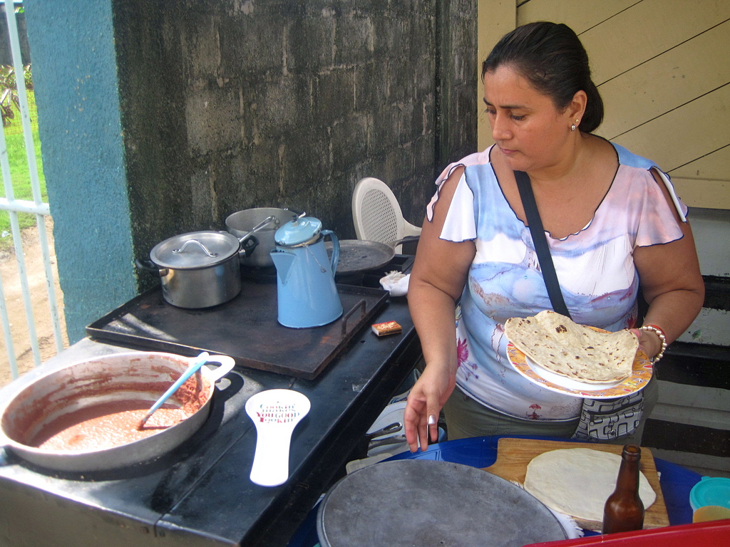 Tasting the traditional baleadas during an Honduras family vacation.