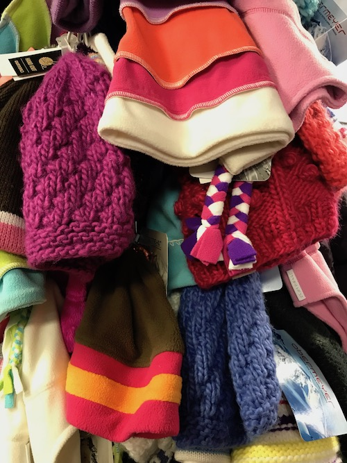 Shopping on a winter girlfriend getaway - A rack of ski hats to choose from for your girls ski trip at one of many PA ski resorts #SkiPA