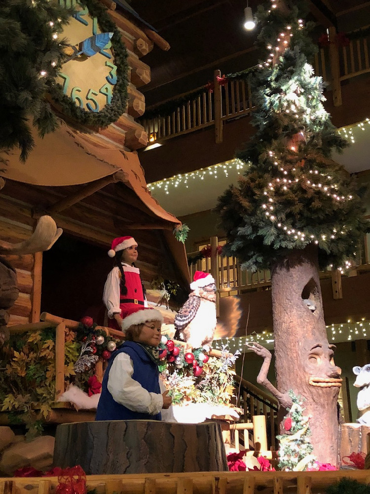 Audio animatronics in a forest setting as part of a clock tower, in Great Wolf Lodge hotels