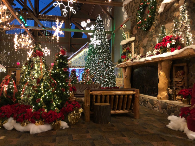the lobby of the Great Wolf Lodge in Mason, Ohio, decorated with snowflakes, Christmas trees, lights, and poinsettias for Snowland.
