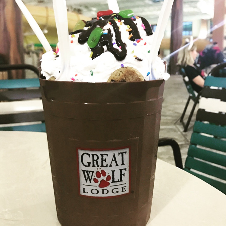 "a brown Great Wolf Lodge ""bucket"" holding a large ice cream sundae, from Buckets - a restaurant in the Great Wolf Lodge indoor waterpark"