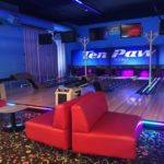 A small bowling alley called Ten Paw bowling at Great Wolf Lodge hotels  - TravelingMom