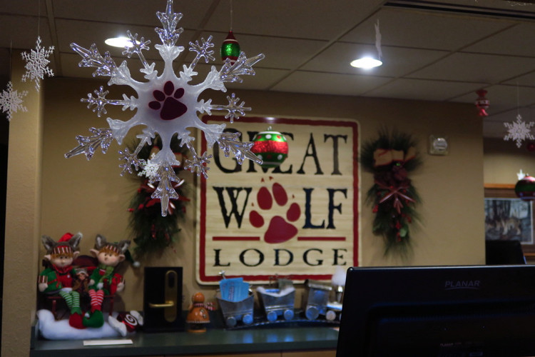 a checking desk at great wolf lodge decorated for snowland during the christmas holiday season
