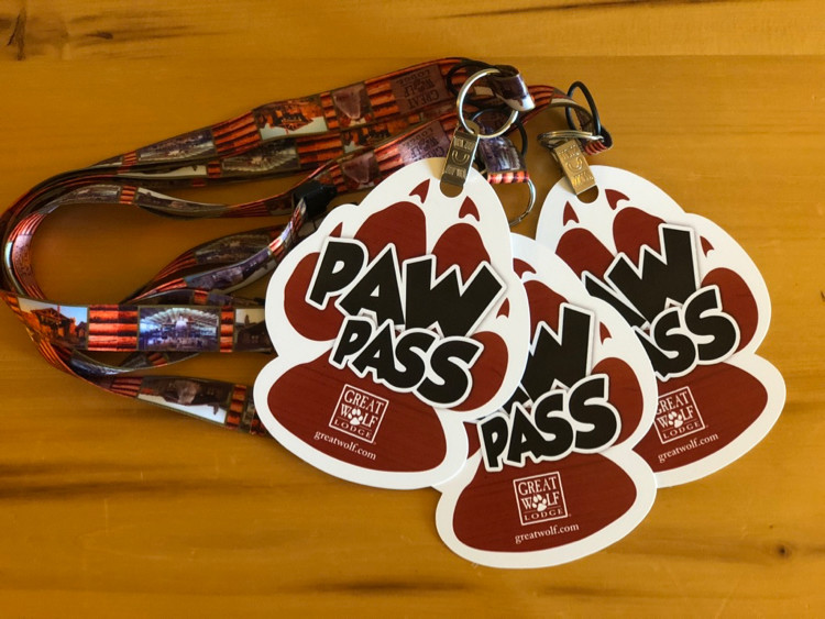 three Great Wolf Lodge paw passes, which provide a discount on many activities and attractions at the hotel