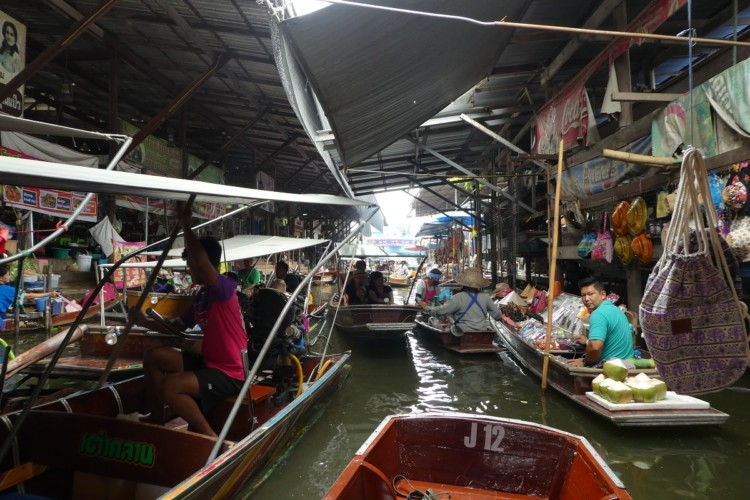 Shopping is fun at the Dumnoen Saduak floating market outside of Bangkok, Thailand with kids.