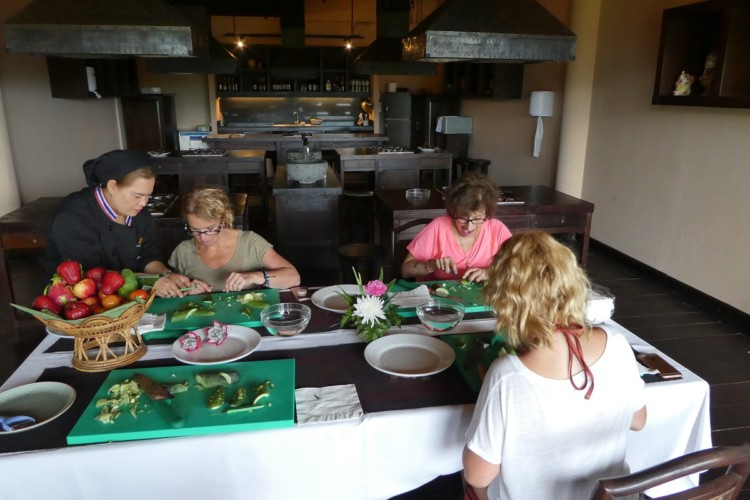 You can learn to carve fruits and vegetables into flowers in a class at the Anantara Golden Triangle Elephant Camp and Resort in Thailand with kids.