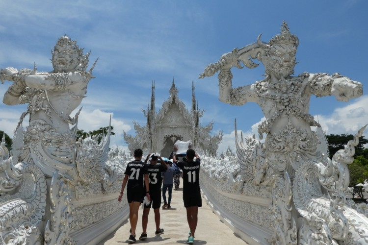 Walking into the White Temple in Chiang Rai, Thailand with kids.