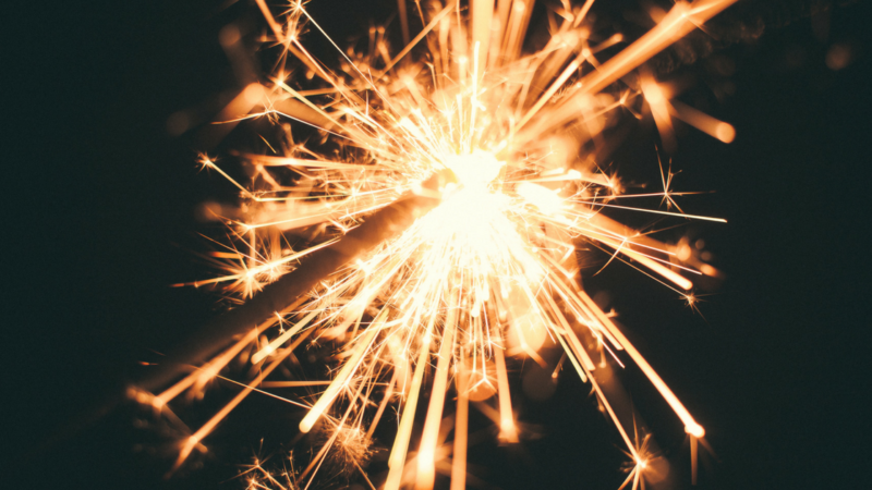Sparklers and an apple side toast is always a win in family friendly New Year's Eve ideas.