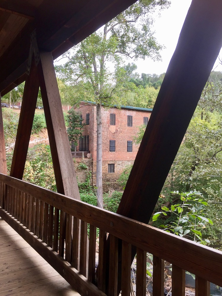 Atlanta suburb Roswell keeps historic mill buildings in site of the beautifully restored covered bridge.