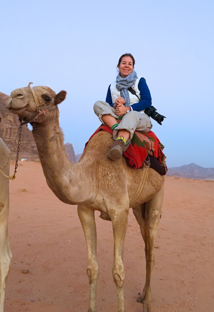 Ride a camel across the desert. How to plan a trip to Jordan with kids.