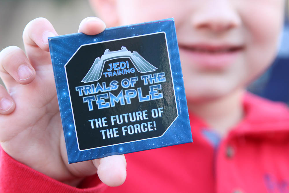 Kids get a pin after completing Jedi Training Academy in Hollywood Studios.