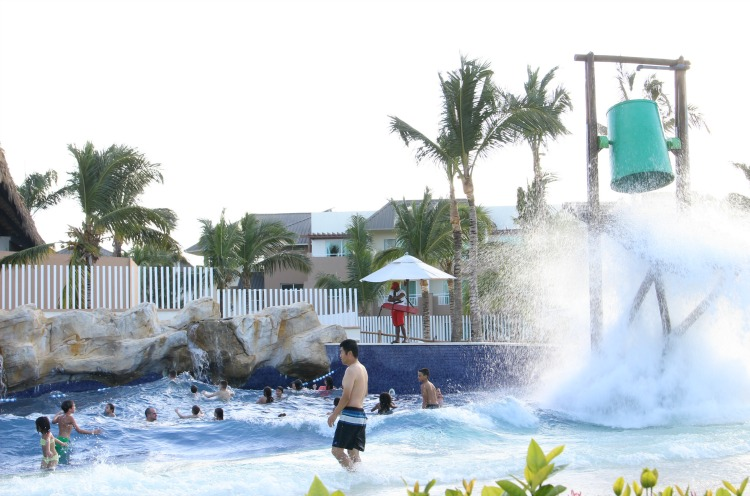 Kids will enjoy playing in the wave pool at Memories Splash Punta Cana