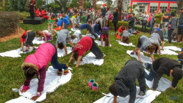 Kids get to do yoga stretches on the lawn at LEGOLAND Florida NINJAGO Days!