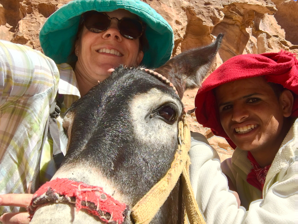 Ride a donkey in Petra. How to plan a trip to Jordan with kids.