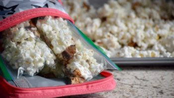Pack white chocolate popcorn as a treat for your next road trip.