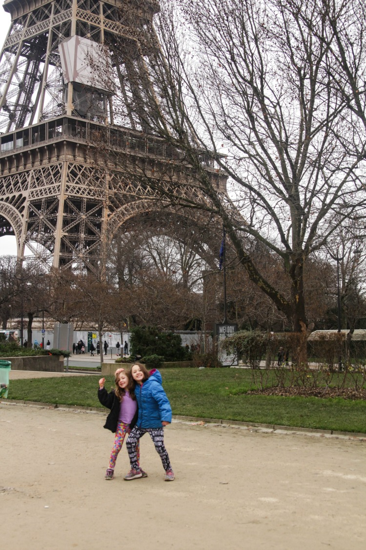 One of the best tips for visiting Europe with kids? Take silly photos in front of the Eiffel Tower is always an iconic spot when traveling Europe with kids