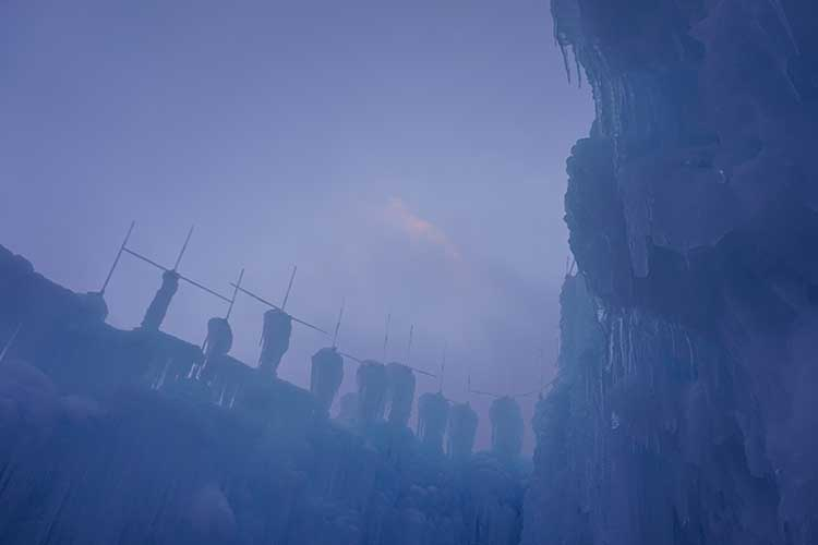 Visiting Ice Castles with kids where harvested icicles eventually become part of impressive structure.