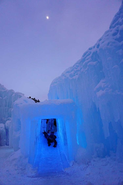Visiting Ice Castles with kids at sunset at Dillon Ice Castles.