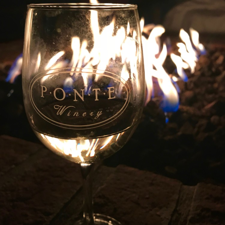 Enjoy a glass of wine by the fire at the Ponte Vineyard Inn during 2 days in Temecula CA - it's one of many great things to do