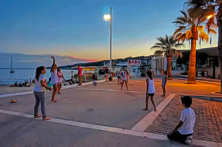 Local kids playing into the night at picture perfect Cassis in France.