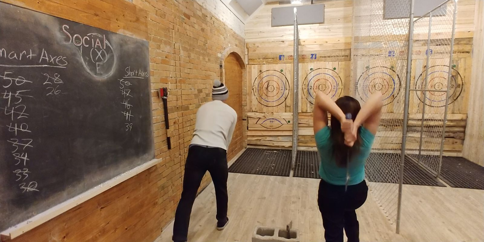 Fun things to do in Ogden after a day on the slopes includes a friendly game of axe throwing.