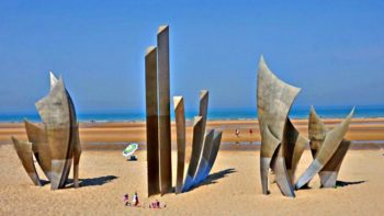 Dramatic Les Braves Sculpture on Omaha Beach, Normandy