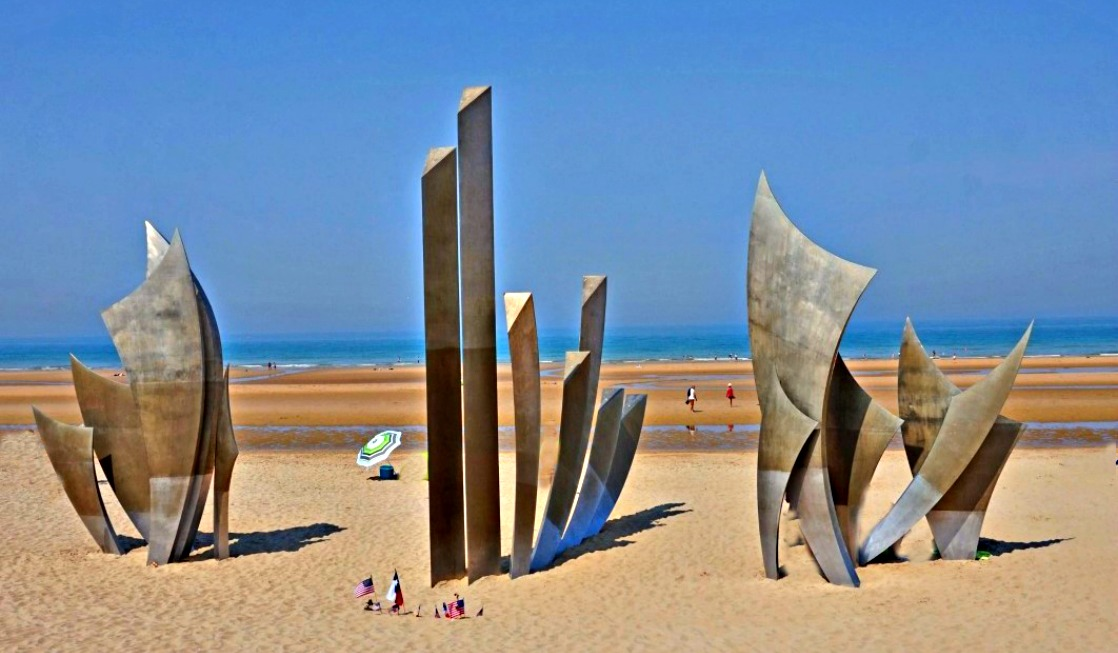 Dramatic Les Braves Sculpture on Omaha Beach where many Americans lost their lives during D-Day invasion in Normandy.