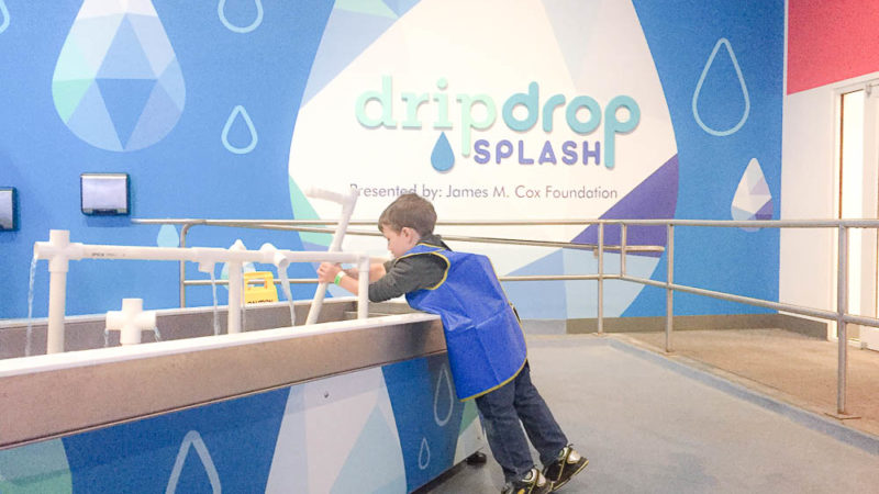 The Orlando Science Center is a great way to spend a rainy day in Orlando. The water table area is tons of fun.