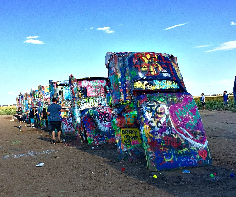 A Texas road trip to Cadillac Ranch, a unique road attraction.