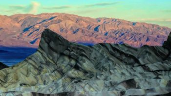 Get up early to witness the spectacular sunrise at Zabriskie Point at Death Valley National Park