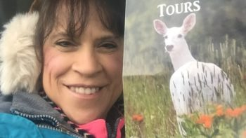 Photo of Fran Capo with White deer of New York.
