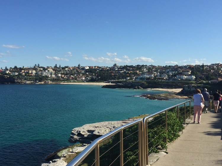 Walk the beach trail at Bondi Beach on a family vacation in Australia
