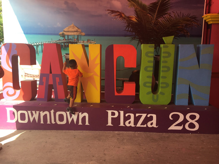 Let the kiddos hang around the sign at Mercado 28 in Cancun for fun photo ops.