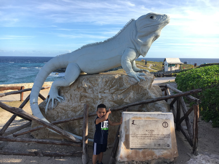 A giant iguana statue at Punta Sur in Isla Mujeres is a perfect spot for a photo when visiting Cancun with kids.