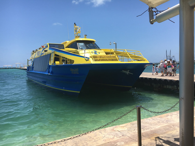 A ferry ride in Cancun is an easy way to see the beautiful sights with kids.