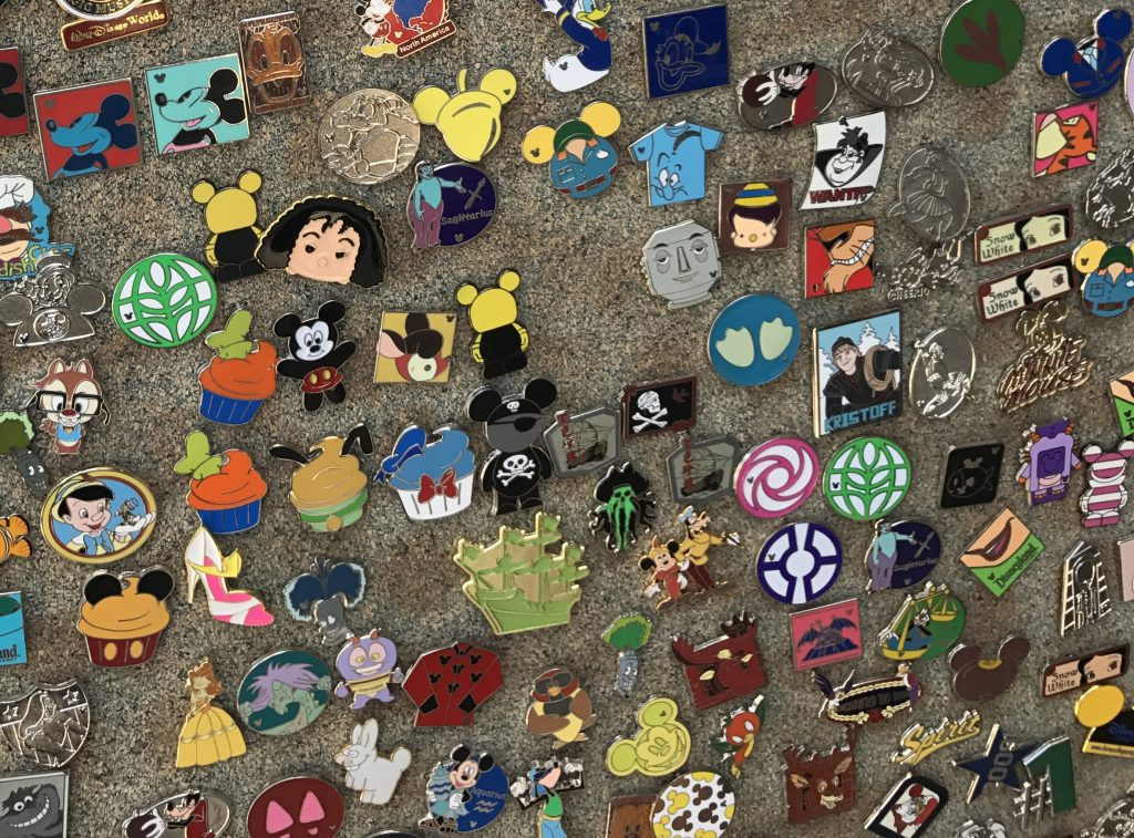 pins on a board at disney for pin trading