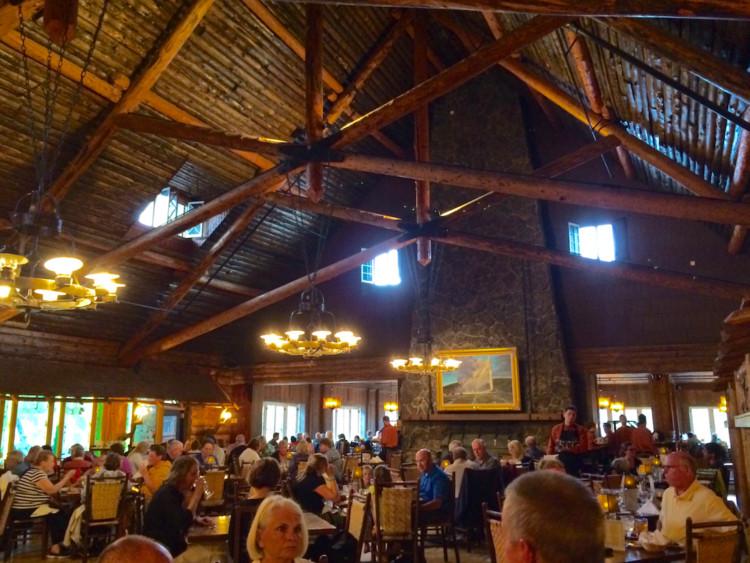 Dine in Old Faithful Inn Dining Room. Old Faithful Geyser in Yellowstone.