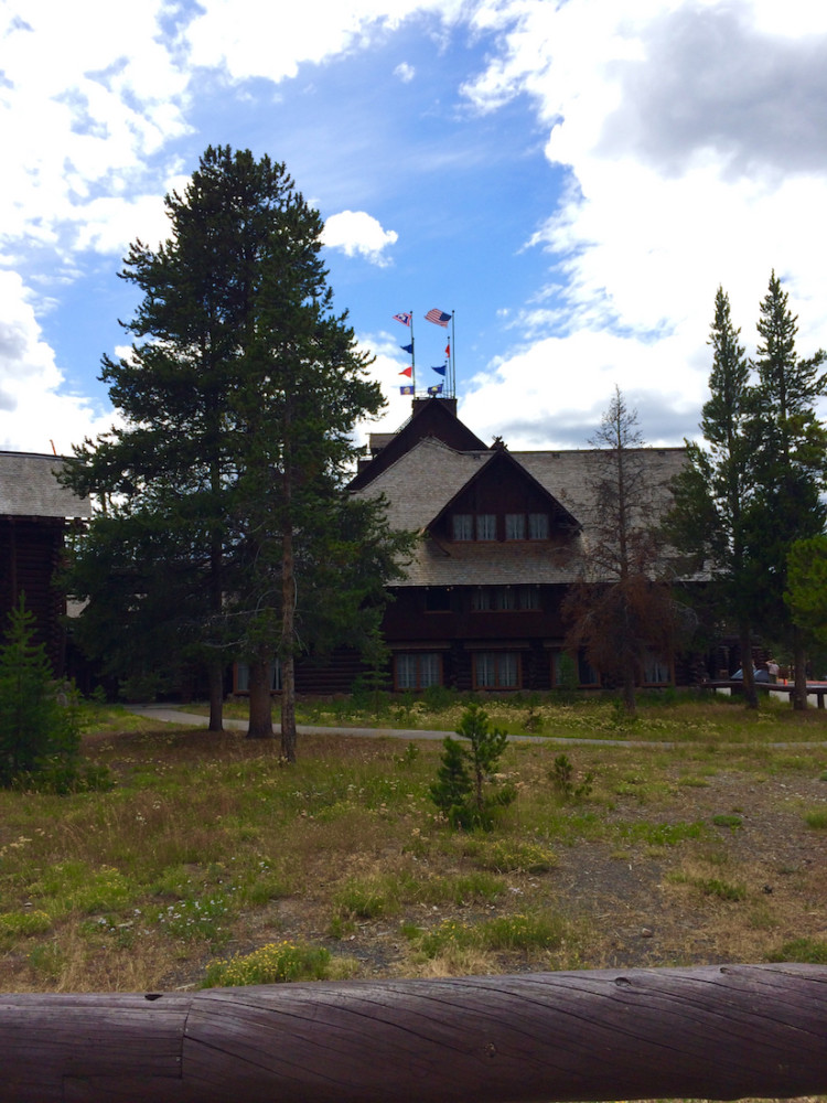 Old Faithful Inn. Old Faithful Geyser in Yellowstone.