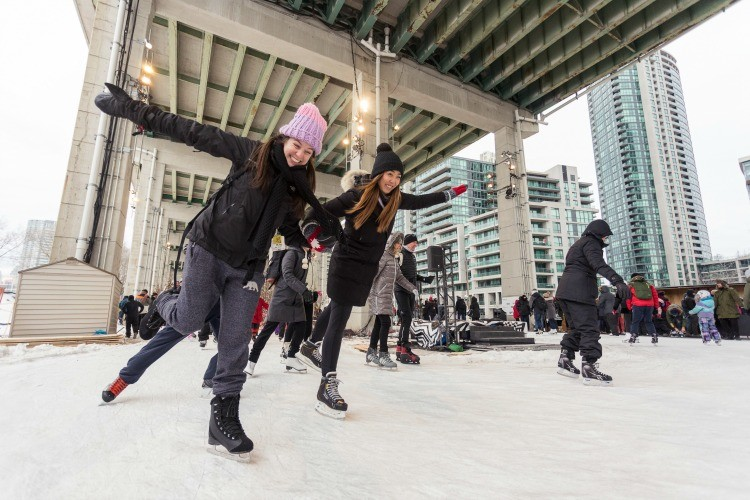Ice skating at the Bentway in Toronto in winter is a fun option to get the kids outdoors!