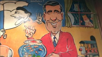 A fun place to visit (and eat!) in Pittsburgh, Primanti Bros. in The strip and its mural with Mr. Rogers.