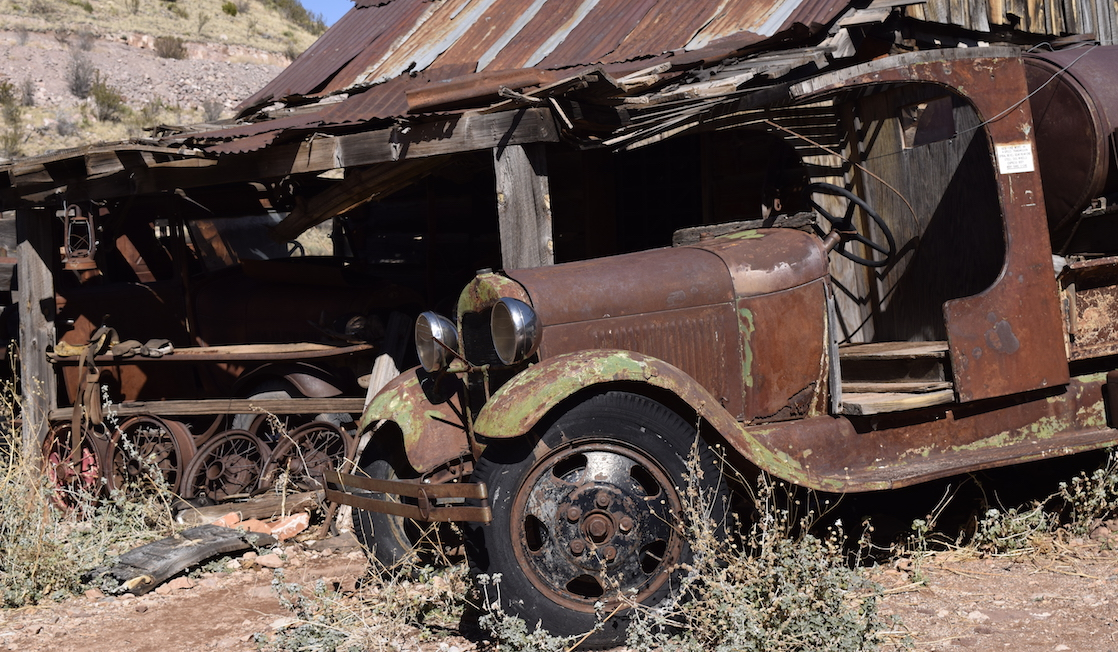 junked truck and ghost town house at Gold King Mine in Jerome AZ - TravelingMom