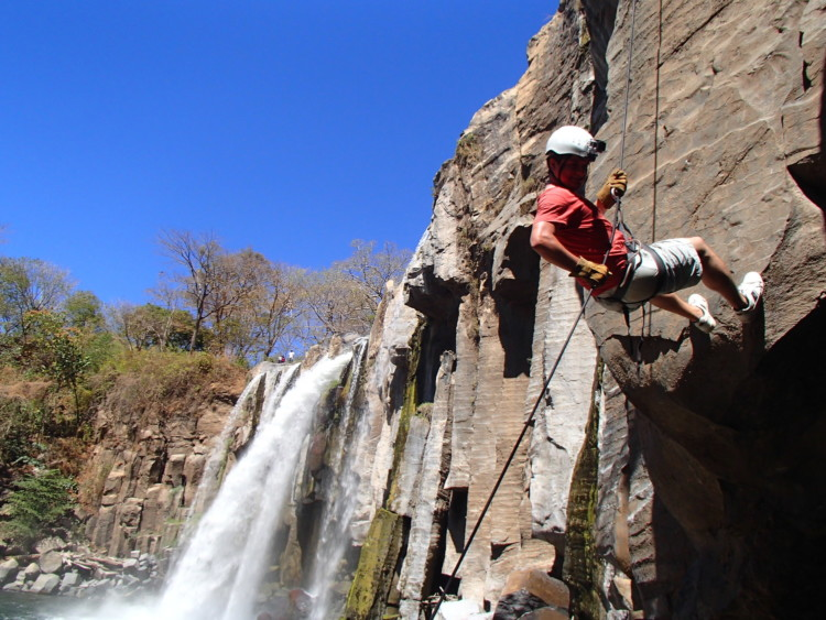 Waterfall rappelling in guatemala - Adventure travel