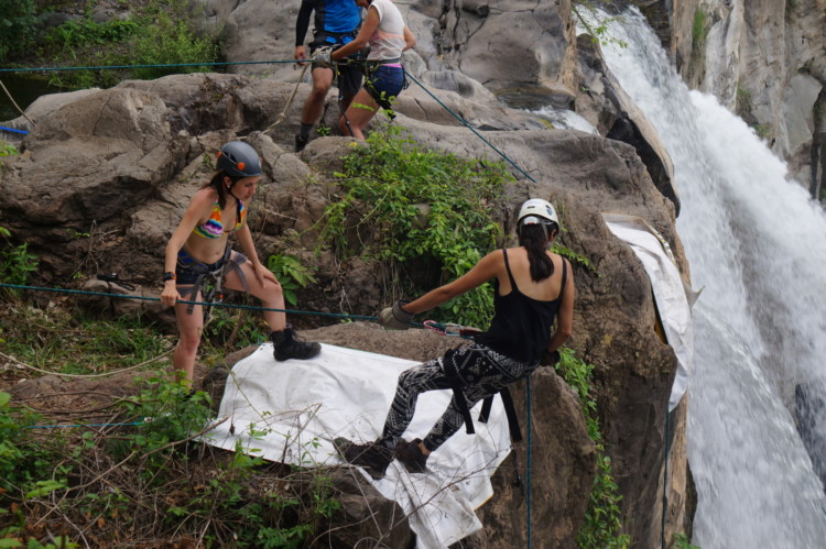 Learning to rappel on a Guatemala waterfall.