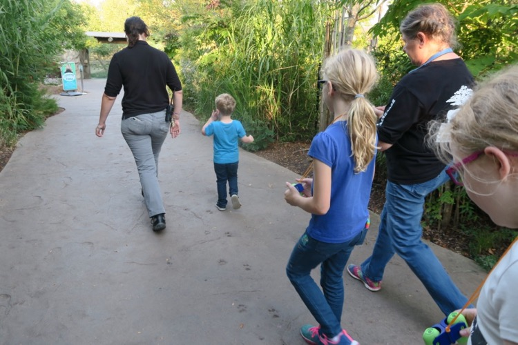 a Cincinnati zoo guide and three guests take a walk on a behind-the-scenes tour
