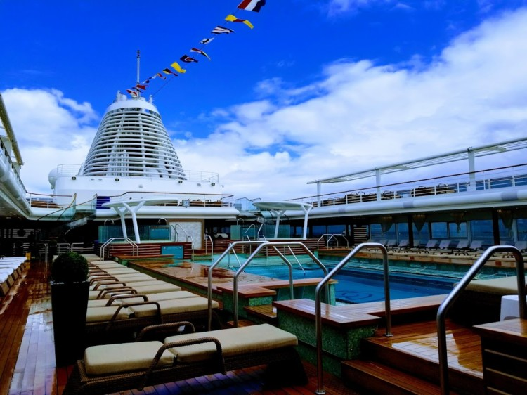 Cruising Europe in style includes lounging on the top deck pool of the Regent Seven Seas Cruise.