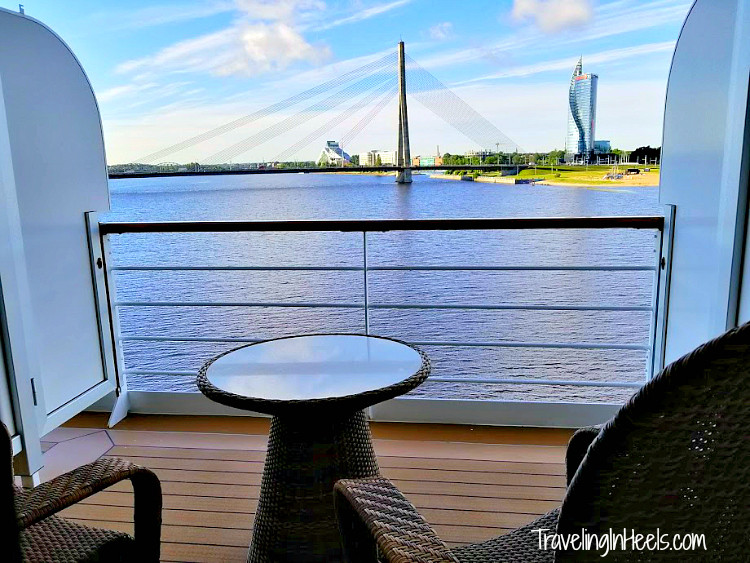 Cruising Europe in style. This. View. Verandah balcony onboard Regent Seven Seas with this amazing view of Riga, Latvia.