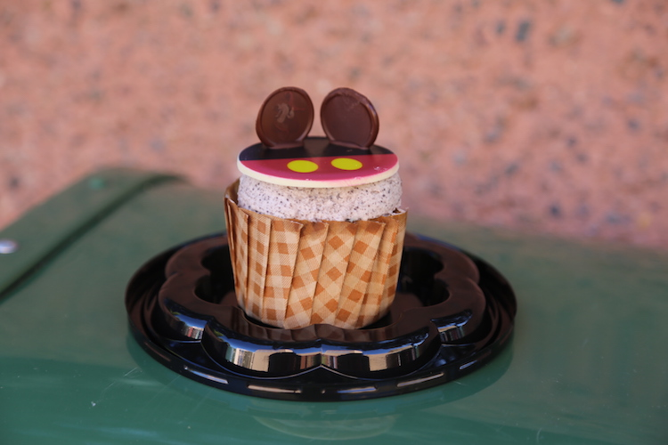specialty cupcake for Mickey's birthday, available at Sunshine Seasons and other places with Disney World snacks - TravelingMom