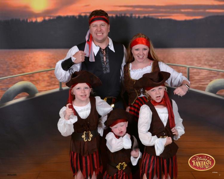 a family is dressed up as pirates on the Disney Fantasy for Pirate Night