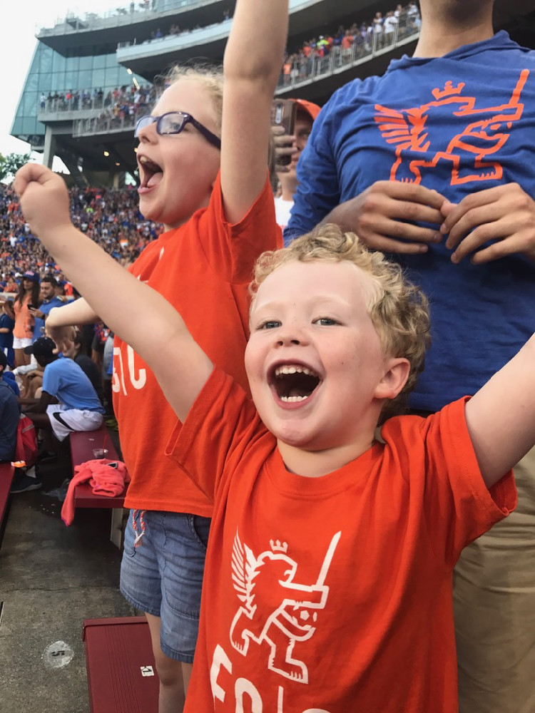a family cheers after an FC Cincinnati Soccer goal during a match at Nipper Stadium, on the University of Cincinnati campus