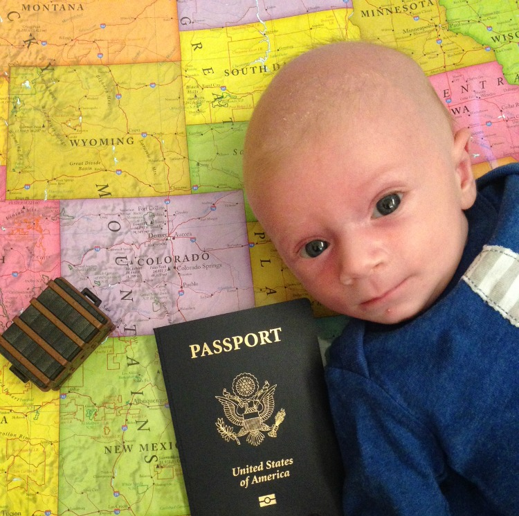 baby boy lying on a map with a passport - TravelingMom